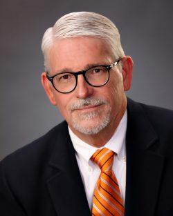Vernon Delpesce, Development Specialist